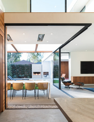 Contemporary Dining Room by Walker Workshop