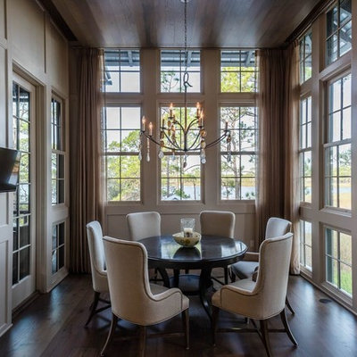 Small transitional dark wood floor kitchen/dining room combo photo in Miami with beige walls and no fireplace