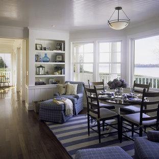 Aménagement d'une salle à manger craftsman fermée et de taille moyenne avec un mur blanc, un sol en bois clair et aucune cheminée.