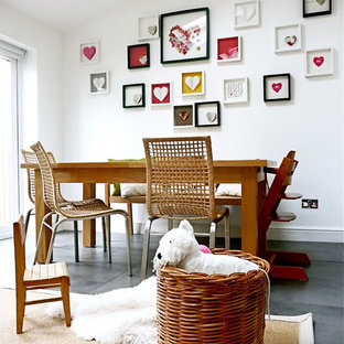 This is an example of an eclectic dining room in London with slate flooring.