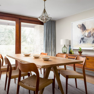 Inspiration for a large farmhouse dining room in Gloucestershire with beige walls, light hardwood flooring and no fireplace.