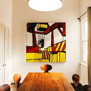 Design ideas for a mid-sized contemporary separate dining room in Melbourne with dark hardwood floors.