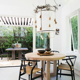 Design ideas for a country kitchen/dining combo in Sydney with white walls and grey floor.