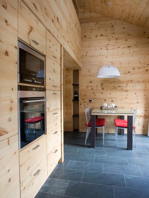 rustikale esszimmer mit schieferboden design ideen. Black Bedroom Furniture Sets. Home Design Ideas