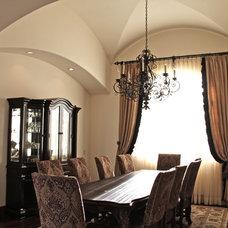 Mediterranean Dining Room by Liggatt Development, Inc