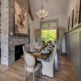 Farmhouse light wood floor and beige floor dining room photo in Kansas City with beige walls, a standard fireplace and a brick fireplace