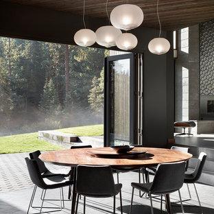 На фото: огромная гостиная-столовая в стиле модернизм с полом из керамогранита, горизонтальным камином, фасадом камина из плитки, серым полом и серыми стенами