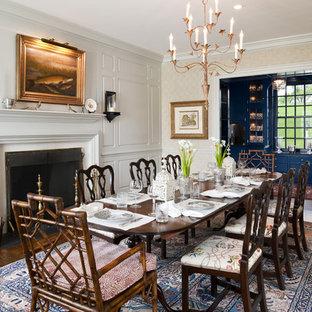 Esempio di una grande sala da pranzo chic chiusa con pareti beige, parquet scuro, camino classico e cornice del camino in legno