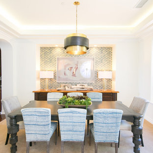 Photo of a coastal enclosed dining room in Orange County with white walls, carpet, no fireplace and beige floors.