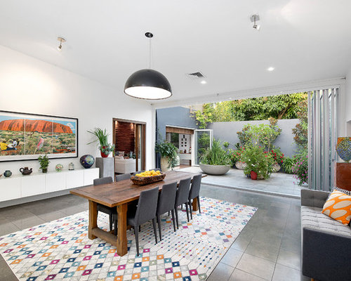 Inspiration For An Eclectic Dining Room In Sydney With White Walls And Grey Floor