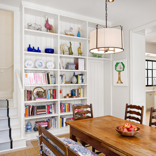 Example of a country enclosed dining room design in Houston with white walls