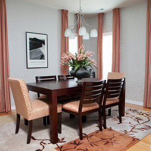 Mid-sized elegant medium tone wood floor and brown floor dining room photo in Raleigh with gray walls and no fireplace