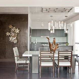 Example of a trendy dark wood floor kitchen/dining room combo design in Boston with white walls