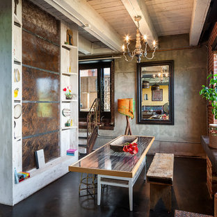 Example of a mid-sized urban concrete floor dining room design in Portland with no fireplace