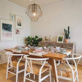 Idee per una piccola sala da pranzo aperta verso il soggiorno scandinava con pareti bianche e pavimento in gres porcellanato