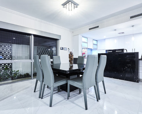 Photo Of A Contemporary Kitchen/dining Combo In Perth With White Walls.