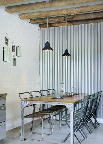 Industrial Dining Room by PAD studio