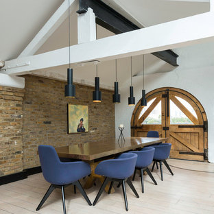 Design ideas for an urban dining room in London with white walls, painted wood flooring and no fireplace.
