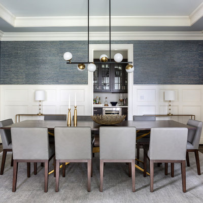 Inspiration for a transitional dark wood floor and brown floor dining room remodel in DC Metro with blue walls