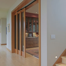 Contemporary Dining Room by J.A. Hand Construction, Inc.