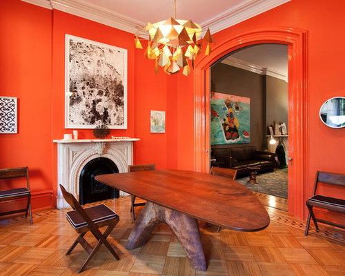 Salle manger moderne avec un mur orange photos et for Salle a manger warren