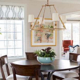 Пример оригинального дизайна: гостиная-столовая среднего размера в стиле современная классика с темным паркетным полом, коричневым полом, бежевыми стенами, стандартным камином и фасадом камина из дерева