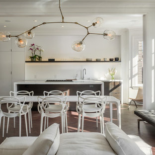 Inspiration for a contemporary dark wood floor great room remodel in San Francisco with white walls