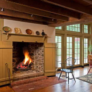 Design ideas for a country kitchen/dining combo in Philadelphia with white walls and medium hardwood floors.