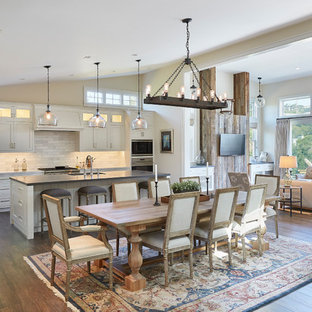 Inspiration for a beach style open plan dining room in San Francisco with beige walls, dark hardwood flooring and brown floors.