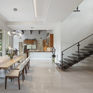 Inspiration For A Contemporary Beige Floor Kitchen/dining Room Combo  Remodel In Austin With Gray