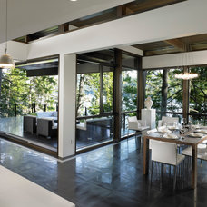 Contemporary Dining Room by Sarah Gallop Design Inc.