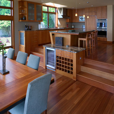 Trendy medium tone wood floor kitchen/dining room combo photo in Seattle with no fireplace