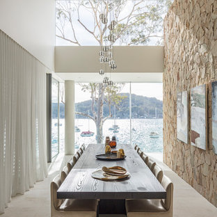 Coastal enclosed dining room in Sydney with white walls and white floors.