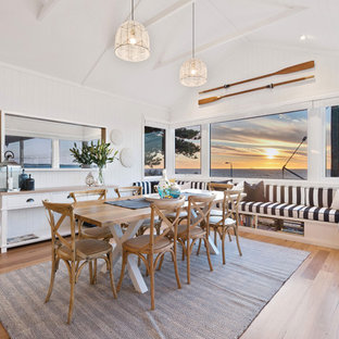 Large beach style dining room in Perth with white walls, medium hardwood floors and brown floor.