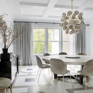 Réalisation d'une salle à manger design avec un mur blanc, aucune cheminée et un sol multicolore.