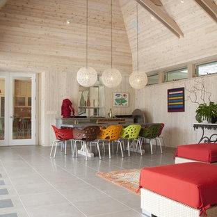 Esempio di una sala da pranzo aperta verso il soggiorno contemporanea con pavimento con piastrelle in ceramica