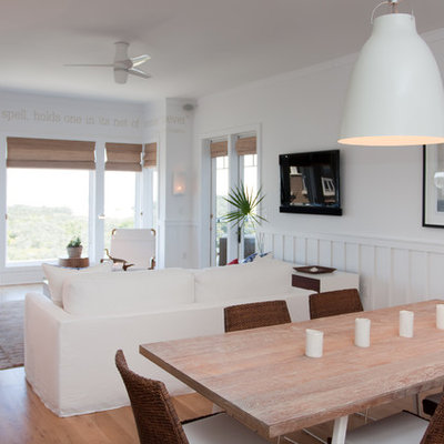 Dining room - coastal dining room idea in Miami with white walls