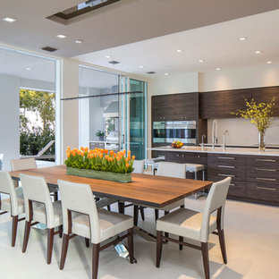 Large trendy beige floor kitchen/dining room combo photo in Jacksonville with white walls