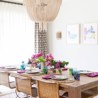 Photo of a tropical dining room in Perth with white walls.