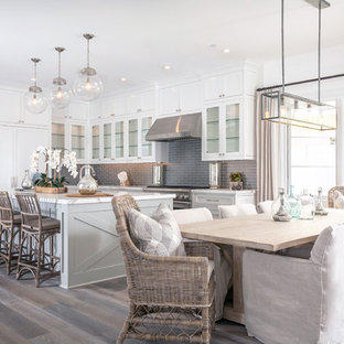 Photo of a beach style kitchen/dining room in Orange County with white walls and dark hardwood flooring.
