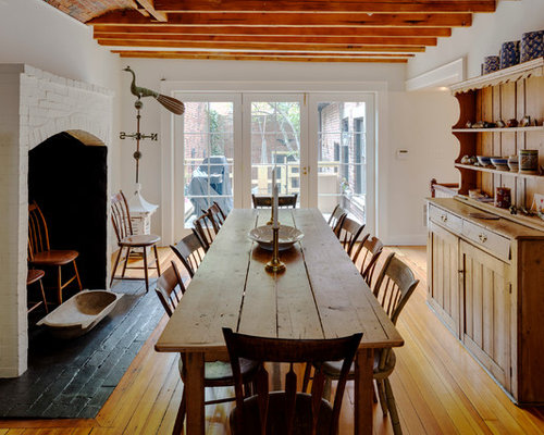 Large Country Medium Tone Wood Floor Enclosed Dining Room Photo In Boston With White Walls