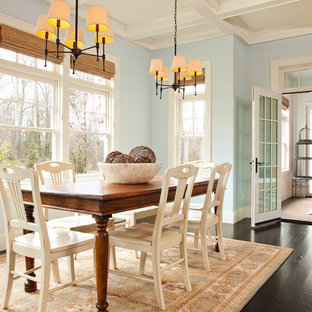 Photo of a large traditional kitchen/dining combo in Portland with blue walls, dark hardwood floors and brown floor.