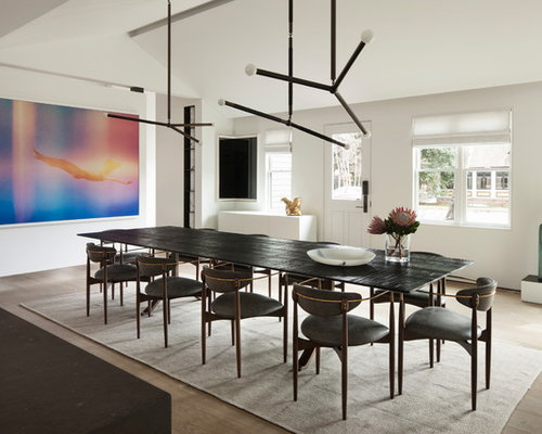 Example Of A Trendy Dining Room Design In New York With White Walls, Light  Wood