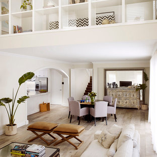 Example of a mid-sized coastal light wood floor and beige floor great room design in Perth with white walls