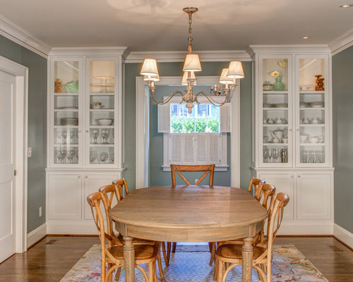 Example Of A Classic Dining Room Design In Portland With Gray Walls And Dark Wood Floors