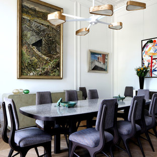 Medium sized traditional dining room in London with white walls, light hardwood flooring and beige floors.