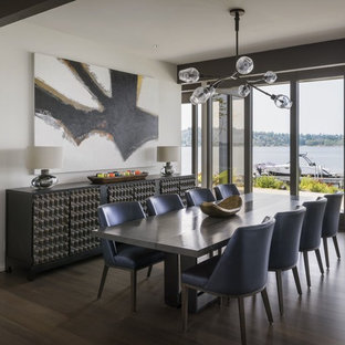 Inspiration for a contemporary brown floor and dark wood floor dining room remodel in Seattle with white walls