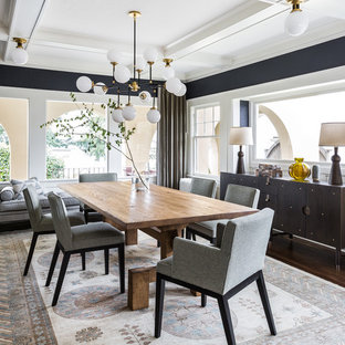 Inspiration for a transitional dark wood floor dining room remodel in Seattle with black walls