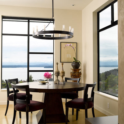 Dining room - contemporary medium tone wood floor dining room idea in Seattle with white walls