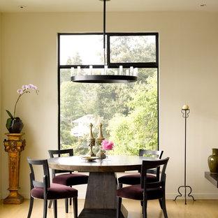 Trendy medium tone wood floor dining room photo in Seattle with beige walls